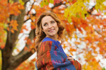 autumn portrait of beautiful stylish young woman in blue knitted
