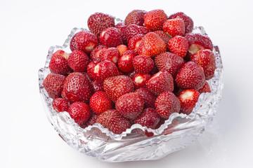 Sweet ripe cleaned strawberries in  crystal bowl.