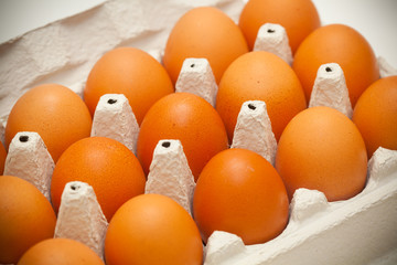 Chicken eggs of brown color in packaging