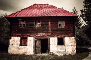 Haunted house with broken window
