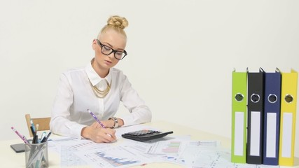 Young Businesswoman Calculating financial data analyzing