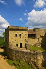 Old stone medieval castle under blue sky