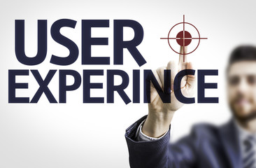 Business man pointing the text: User Experience