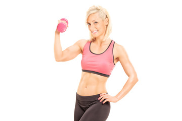 Female athlete exercising with a pink dumbbell