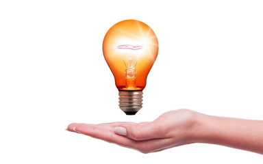 Light bulb over hand