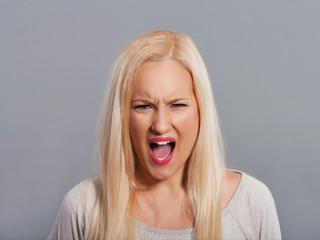 Frustrated young woman shouting.