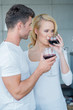 Young couple enjoying a glass of red wine