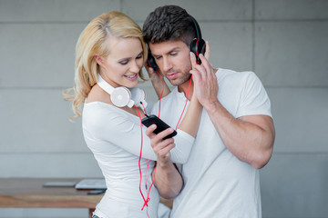 Sweet Couple Listening Music in Phone