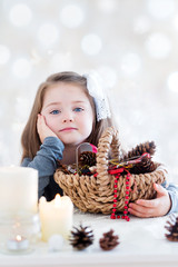 Child with Christmas decoration