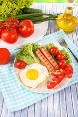 Scrambled egg with vegetables and sausage served in plate