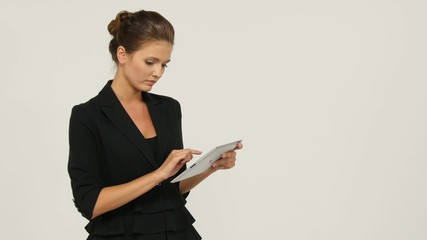 Business woman holding tablet computer isolated on white