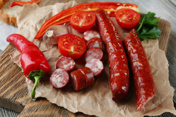 Smoked thin sausages and vegetables