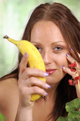 Lovely nature girl with banana, a healthy life portrait