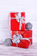 Red holiday gift boxes decorated with ribbon