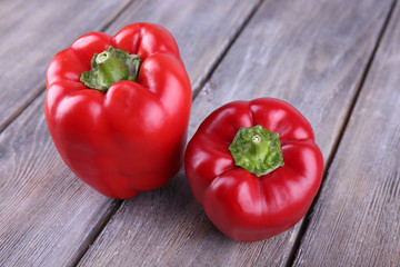 Red pepper on wooden background