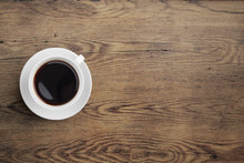 "Постер, картина, фотообои ""Black coffee cup on old wooden table top view"""
