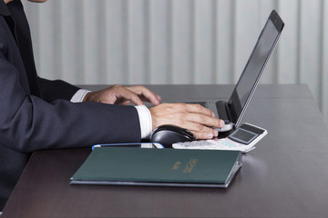 business man using the laptop