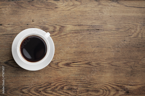 Black coffee cup on old wooden table top view - 71671657