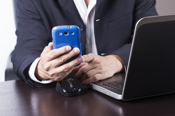 businessman working and holding smart phone