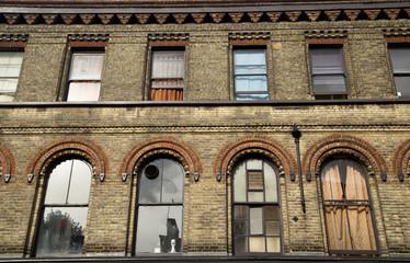 the exteriro of a block of london flats.