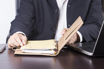 businessman opening his notebook