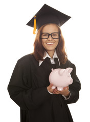 Graduation holding pink piggy bank