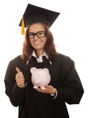 Graduation holding pink piggy bank