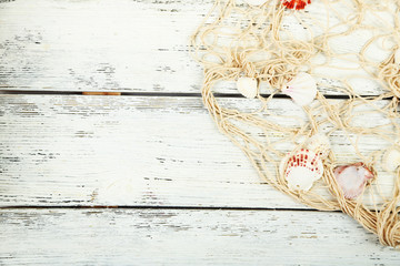 Decor of seashells on wooden table background