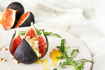 Ripe sweet fig with cottage cheese and honey, on plate