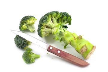 chopping broccoli with knife isolated on white background