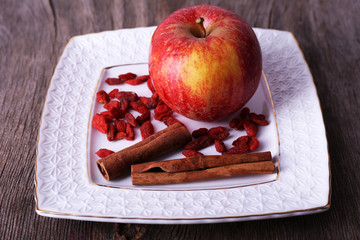 Ripe apple, goji berries and cinnamon