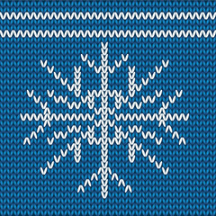 knitted christmas pattern white snowflake on a blue background