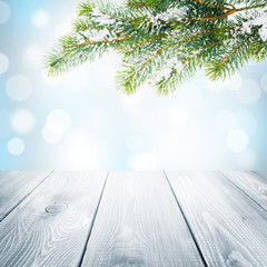 Christmas winter background with snow fir tree and wooden table