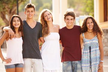 Portrait Of Teenage Group Walking Along Street