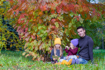 Cute little girls with happy dad enjoy autumn vacation