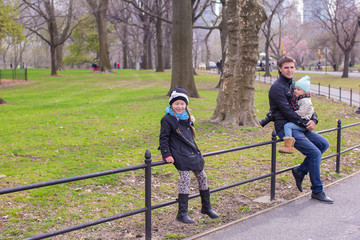Young father and little daughters in Central Park