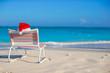 Santa hat on chair longue at tropical white beach