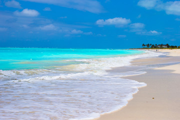 Perfect white beach with turquoise water on Caribbean island