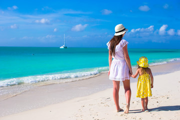 Young mother walking with daughter during vacation