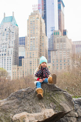 Adorable little girl in Central Park at New York City, America