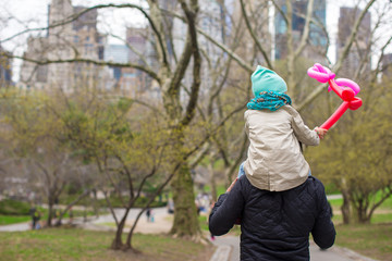 Young father and little daughter for a walk in Central Park