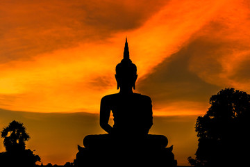 silhouette big buddha statue sitting on sunset