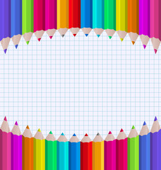 Rainbow of pencils on paper sheet background