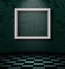 Picture frame in dark empty interior
