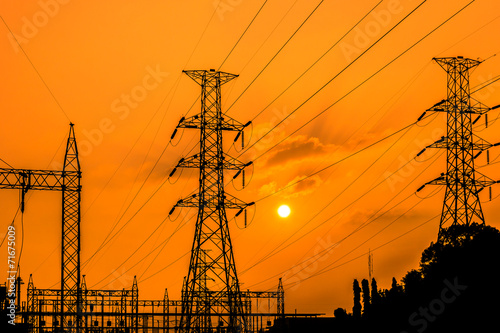 high voltage electric pillars on  sunset background  in thailand