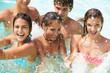 Group Of Teenage Friends Having Fun In Swimming Pool