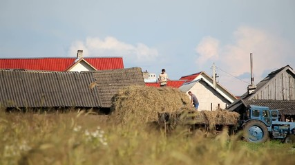 Peasants ship hay in the old