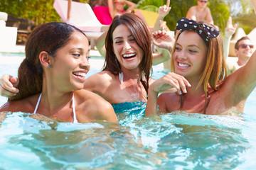 Three Women Having Fun In Swimming Pool