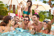 Group Of Friends Having Party In Pool Drinking Champagne - 71675603