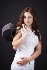 Beautiful young woman with showjuping helmet